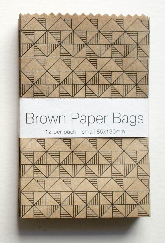 Kraft brown paper bags with geometrical patterns based on a line drawing of a house with chimney. Twelve bags with a different pattern on the front and