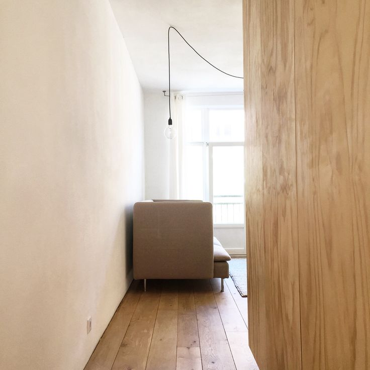 Kanaalstraat Amsterdam, small but very light, flexible and efficient 56 m2 apartment. Here: living room and plywood wardrobe, interior design and styling by Jantiene de Ruijter from Stadslab