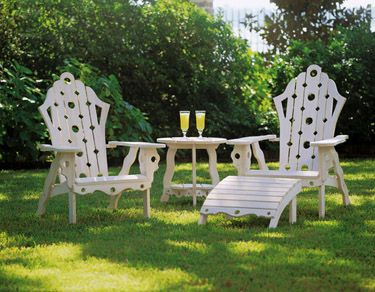 """""""Not-your-usual Adirondack furniture is evocative of Mackinac Island, Nantucket, White Sulphur Springs and other places long associated with gracious summer living. Crafted of cypress, the furniture derives its white wash look from a penetrating stain."""""""