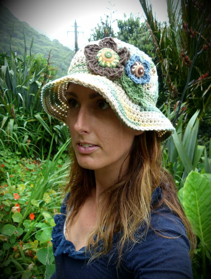 100% cotton women's sun hat in sand, mustard & sage with natural multi-coloured flowers, leaves & accent stripes. Handmade in Aotearoa NZ. www.facebook.com/thelittlebeenz www.etsy.com/shop/thelittlebeenz