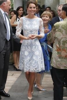 Attending the British High Commission Tea Party, Kate looked fabulous in an icy-blue minidress by Temperley London. The dress featured a detailed sheer lace layer over a simple blue slip and a relaxed boat neckline.