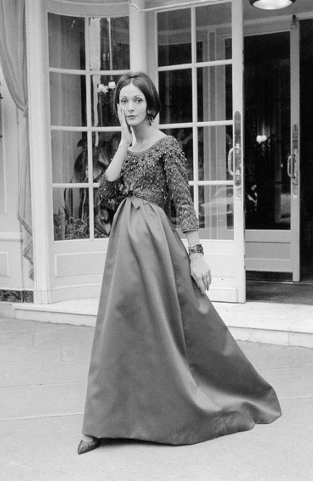1958Kouka Denis in beaded satin evening gown by Yves Saint Laurent for Dior,
