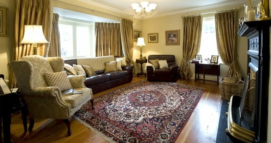 Fully furnished room with silk curtains and upholstered chairs