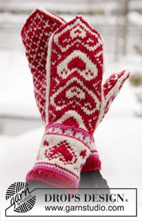 "The Heart of the Mitten - DROPS Valentine: Knitted DROPS mittens with hearts in ""Merino Extra Fine"". - Free pattern by DROPS Design"