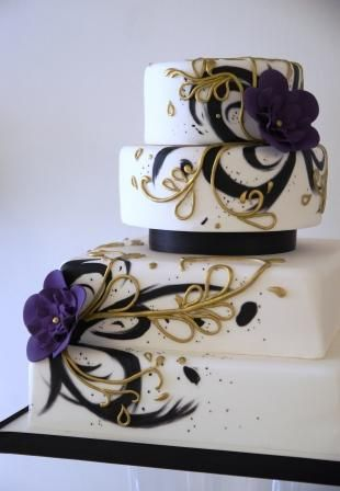 An artistic 4 tier Hand Painted Purple and Gold Wedding Cake made in our cake shop in Bournemouth. Available in Poole, Christchurch and Ringwood The design on this one is pretty. Shape is a bit odd though.