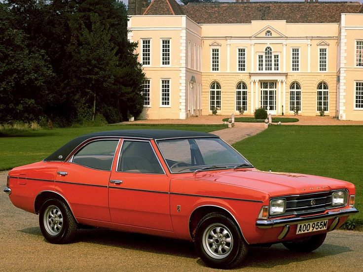 Ford Cortina 4 door Sedan 1970-1976 I had one of these, exactly the same colour, though mine had slightly more than a hint of rust about it, and the same vinyl roof too, except my roof was peeling a bit in various places. :)