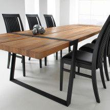 Spisebord i massiv egetræ Olieret Gita 290 cm.  Spisebord af massivt egetræ i et slidstærkt naturmateriale.  Bordpladen er en 50 mm olieret massivt egetræ, meget nem at vedligeholde.  Benene er sortmalet stål  Matriale: Neutral, Olieret, Sort, Malet  Gratis Fragt!
