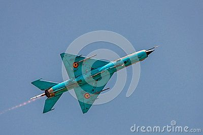 MIG-21 fighter view from bellow, isolated on clear blue sky.The Mikoyan-Gurevich MiG-21 (NATO reporting name: Fishbed) is a supersonic jet fighter aircraft, designed by the Mikoyan-Gurevich Design Bureau in the Soviet Union. It was popularly nicknamed Balalaika, from the aircrafts planform-view resemblance to the Russian stringed musical instrument by Polish pilots due to the shape of its fuselage.