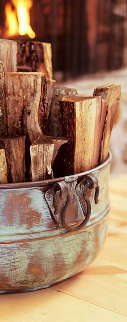 love autumn & winter...pretty photo...I use wicker baskets for firewood but this makes much better sense, won't catch fire by sitting close to fireplace..doing this -Mari