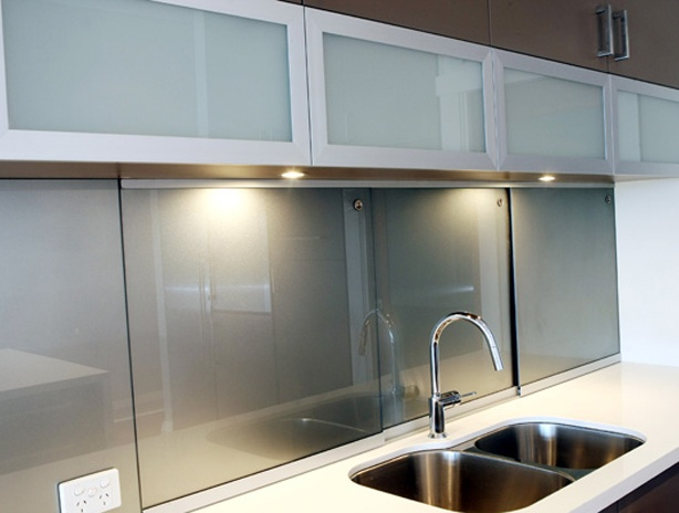 Metallic glass splash back (or in this case sliding doors from Just Glass Perth. A metallic grey will go well with grey cupboards or a white/grey counter top. Glass overhead cupboards