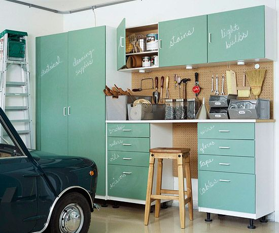 Pegboard + LOVE the mint green chalkboard faced cabinets