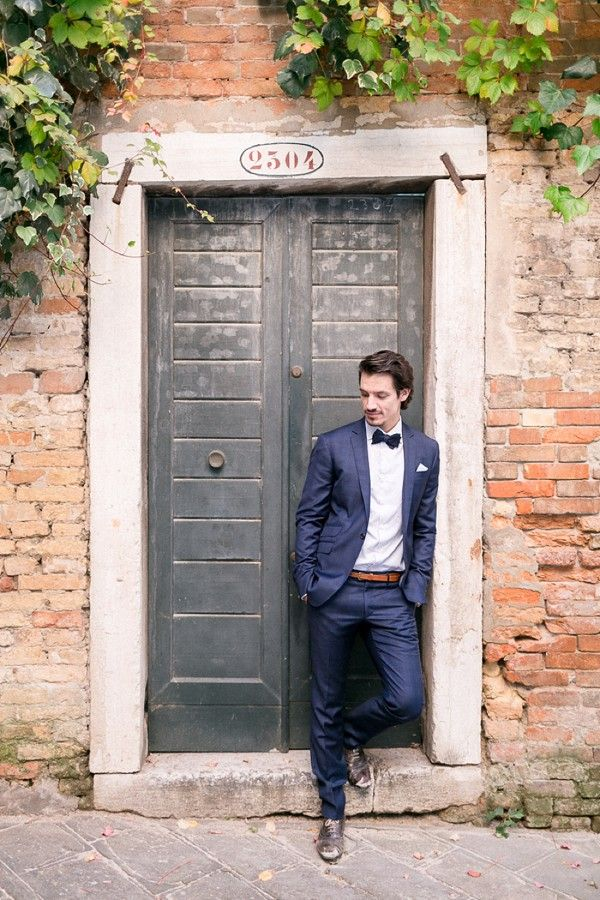 Groom in blue suit and bow. Styled Venice Elopement