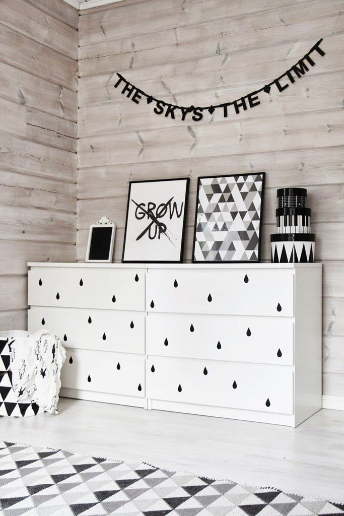 Black drips onto white drawers adds an unusual and effective design detail to this mostly monochrome room