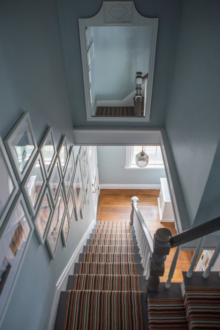 Gallery wall and mirror above stairs - also mirror across from peep hole?