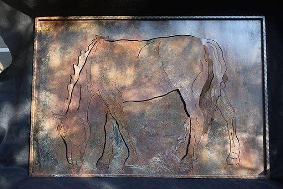 Plasma cut steel profile of a grazing horse
