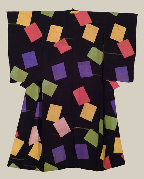 A chirimen silk kimono featuring an abstract design of colored rectangles, some containing small silkscreen designs, with the pink ones containing embroidery highlights. Some gold metallic insert threads.  Taisho to very early Showa Period (1912-1930), Japan.  The Kimono Gallery