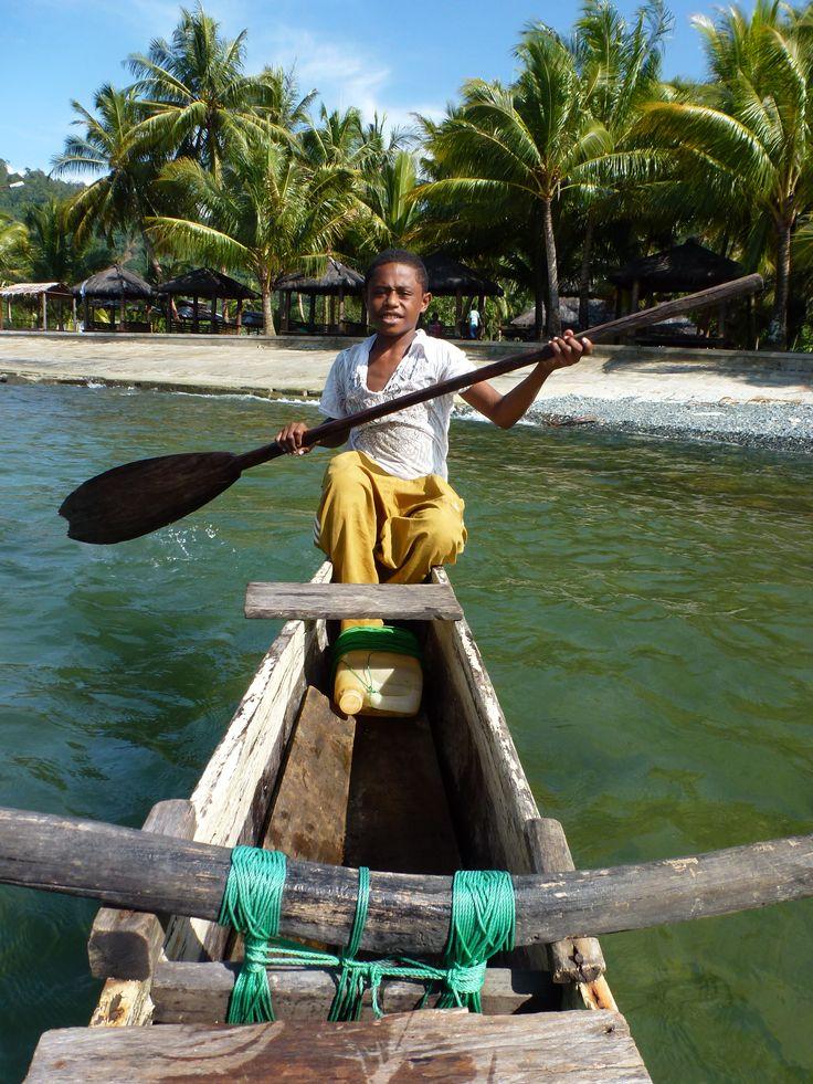 The boy, my boat's captain at Tablanusu beach, Papua, Indonesia