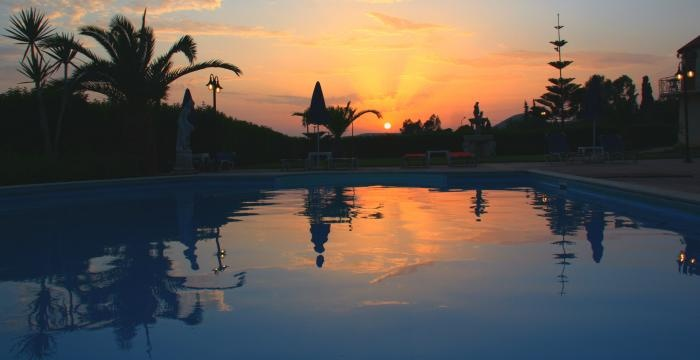 A perfect sunset by the Ideales swimming pool at Marina Anna Studios in Kefalonia