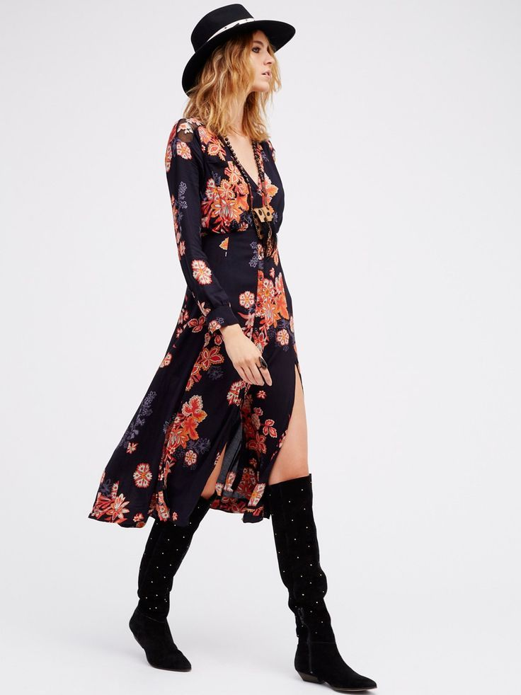 Pretty printed midi dress featuring front button closures and front tassled tie accents. Beautiful embroidery along the shoulders and front slits create a femme look. Cute front pocket detail.