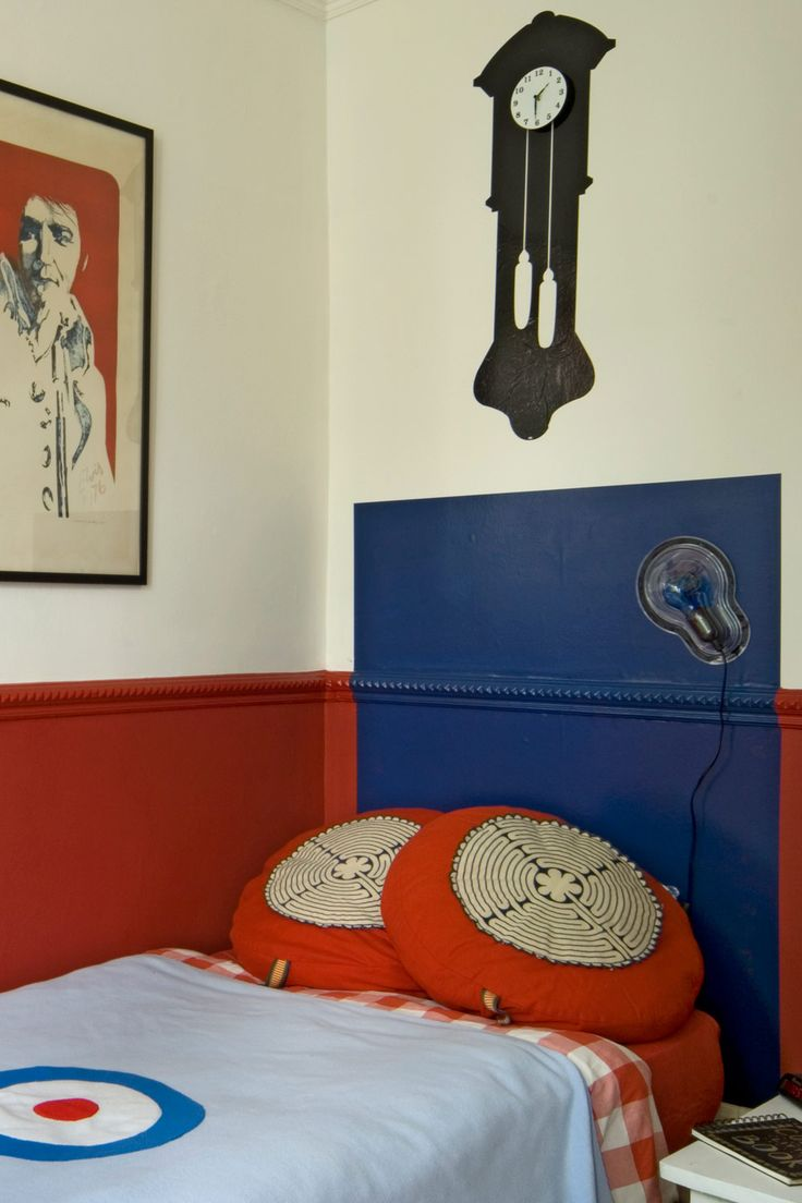 I love that blue paired with the orangey red colours drawing room blue