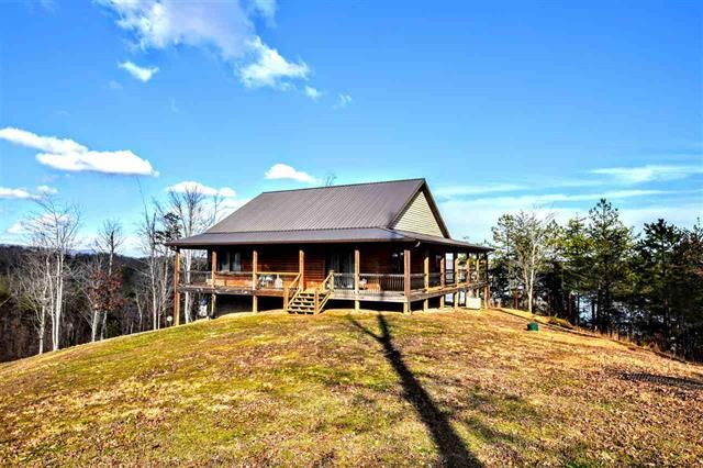 First time on the market, this custom built home is being offered with gorgeous views of the mountains and Watts Bar Lake. Owners take pride in this beautifully decorated home with colors that you will just love. This home offers 3 bedrooms with 2 of these being master suites and 3 full bathroom. The kitchen is ready for a master chef to start working, solid counter tops, double ovens, beautiful working island, and dining area with lake views . $325000.00