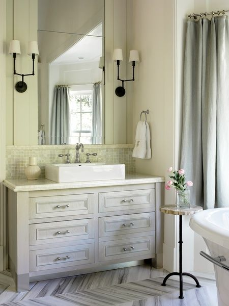 chest of drawers, vessel sink, double sconce. white and gray