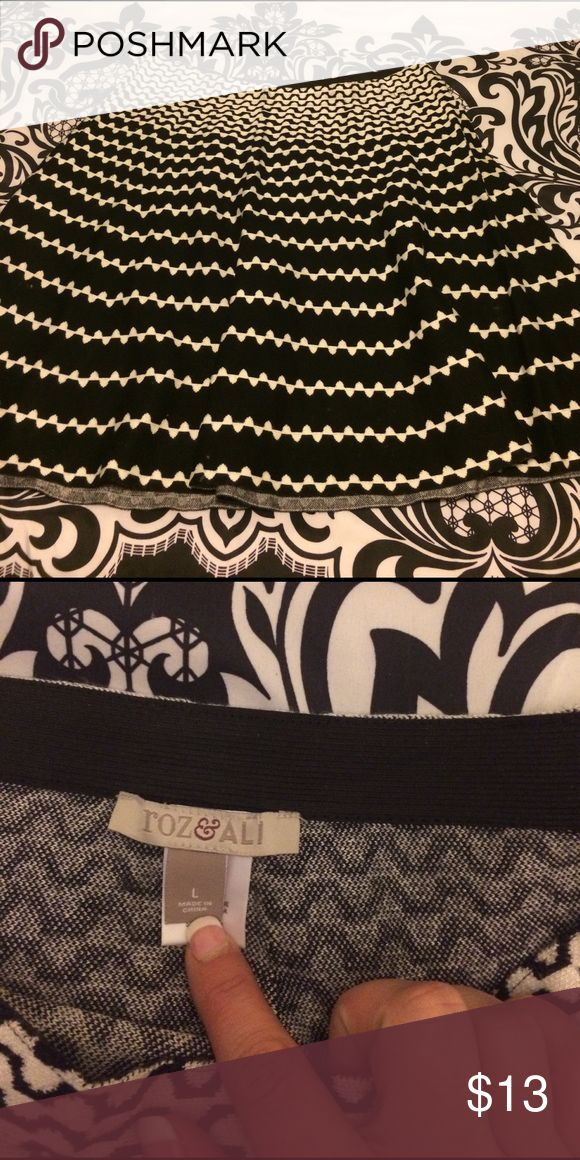 A-line black and white skirt Fun flows a-line skirt can be a professional work day skirt or with the right stilettos and a sexy top can be a martini night out skirt. Bought it at dress barn and never wore it except to try it on. Make an offer! roz and ali Skirts A-Line or Full