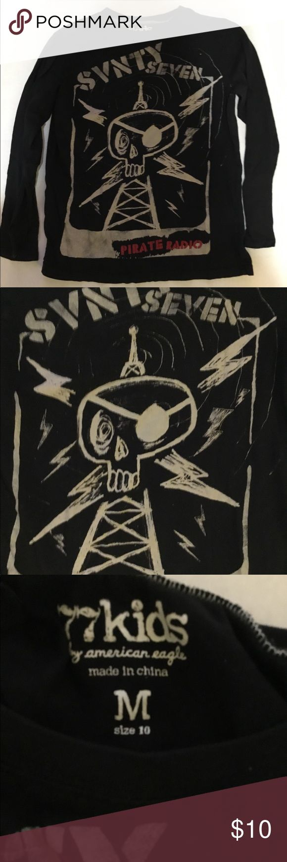 77 Kids long sleeve black t shirt pirate radio Med 77 Kids long sleeve black t shirt pirate radio sz Medium (10). Nice lightweight long sleeve tee from 77 Kids (American Eagle).  Minimal color loss great graphic! 77kids Shirts & Tops Tees - Long Sleeve