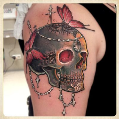 Skull tattoo with butterflies and necklaces. #tattoo #tattoos #ink #inked