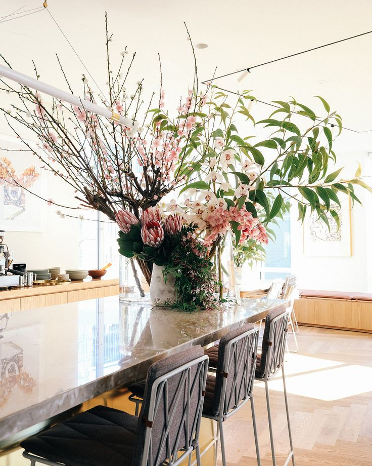 We arranged this large vase for our favourite Sydney interiors store, Jardan. It's filled with stunning cherry blossom branches, eucalyptus, king proteas, cymbidium orchids and flowering jasmine.     Sydney Florist   Event Flowers   Corporate Flowers   Corporate Florist  https://floreatfloral.com.au/