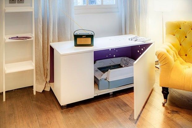 Esse móvel parece um buffet comum. Na verdade, é um cama disfarçada para os gatos.