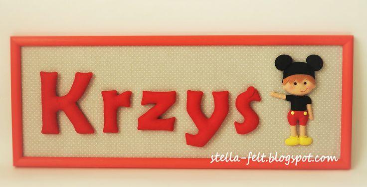 felt name in a wooden frame