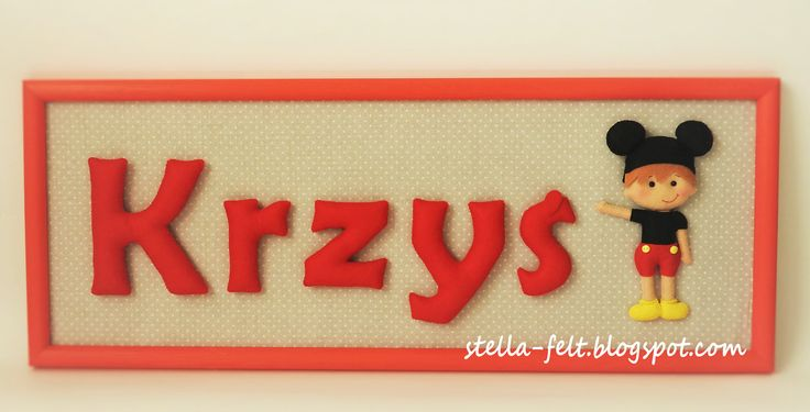 felt name in a wooden frame