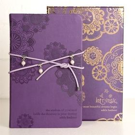 Pearl Wrap Journal in Purple with leather and pearl wrap by Intrinsic. Now available at www.threemadfish.com. Encased in a colour-matching box, which features luscious gold foiling, the embossed journal within is wrapped with a leather and pearl strap that can also be worn around your wrist as a stunning bracelet.