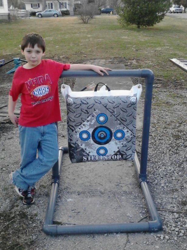 We built this stand out of sch 80 pvc pipe archery for Pvc pipe bow plans