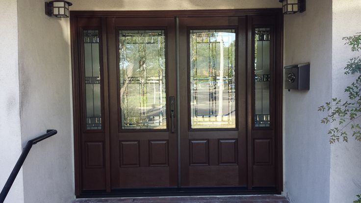 Double door with double side lights makes for a grand for Double opening front doors