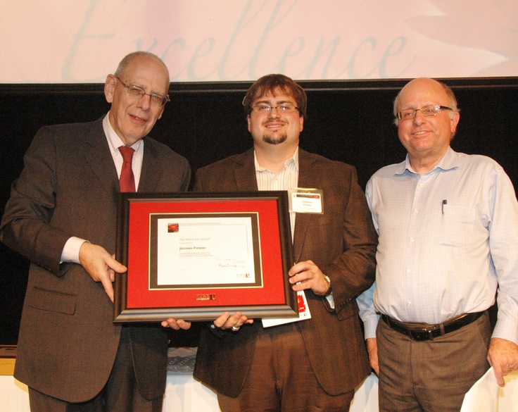 Juliano Pichini, centre, winner of the Helen Vari Award, with Dean Martin Singer, left and Associate Dean Gary Spraakman.