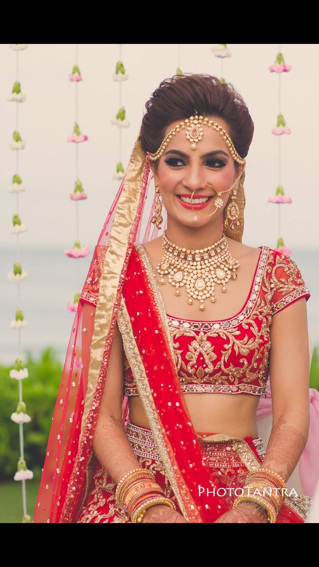 Petite Indian bride looking lush in red lehenga / ghagra choli