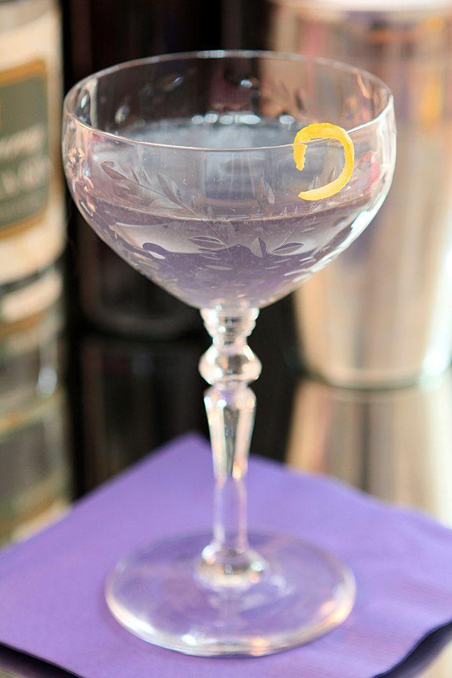 Blue Moon Cocktail 2 oz gin 1/2 oz Creme de Violette 1/2 oz lemon Lemon twist for garnish