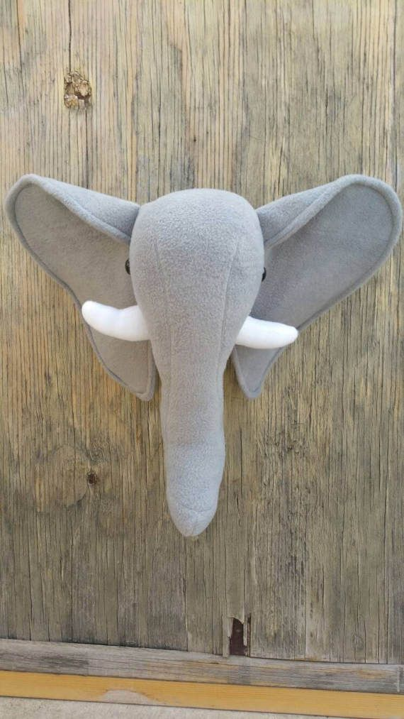 Check out this item in my Etsy shop https://www.etsy.com/listing/517733417/faux-taxidermy-elephant-plush-head-wall