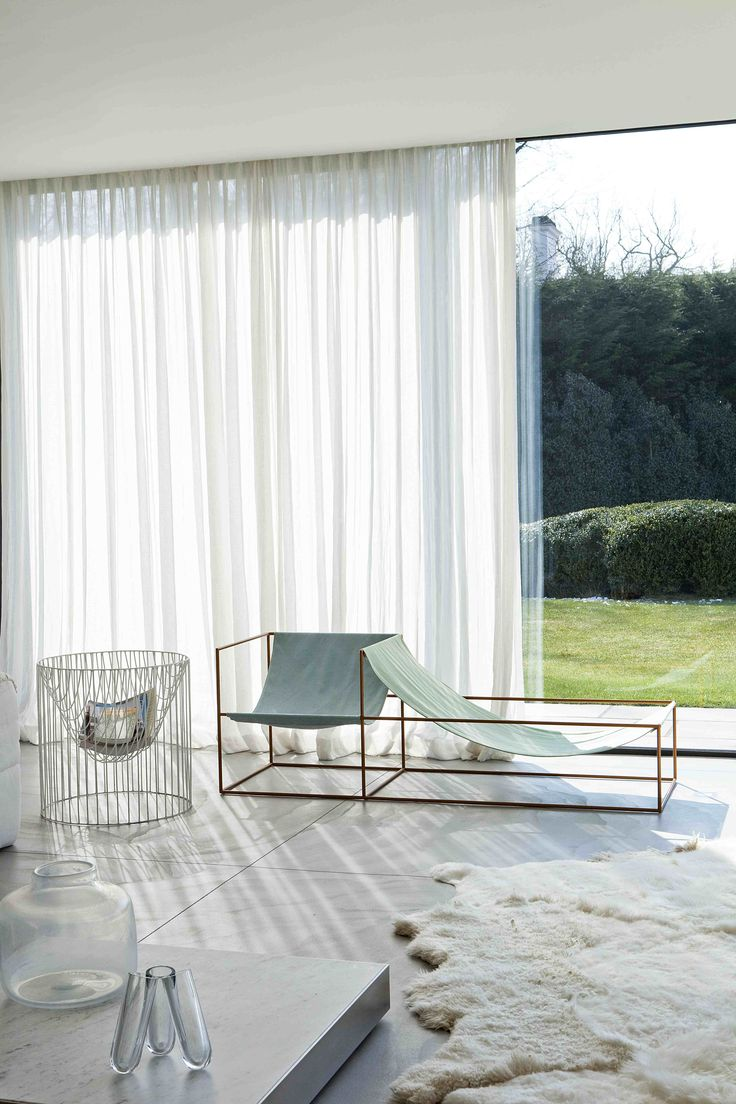 | P | White sheer draperies, seat by Fien van Muller and Hannes van Severen.