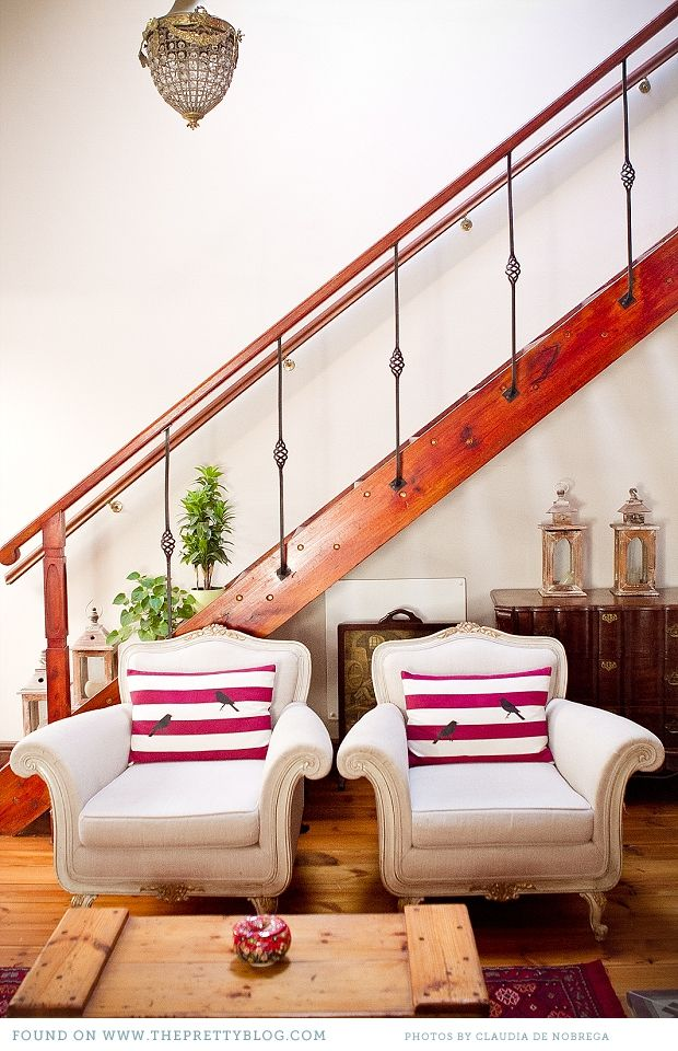 That groovy red staircase isn't up to code, but I'm a fan.  Nice matching chairs + pillows.  + Pine floor.