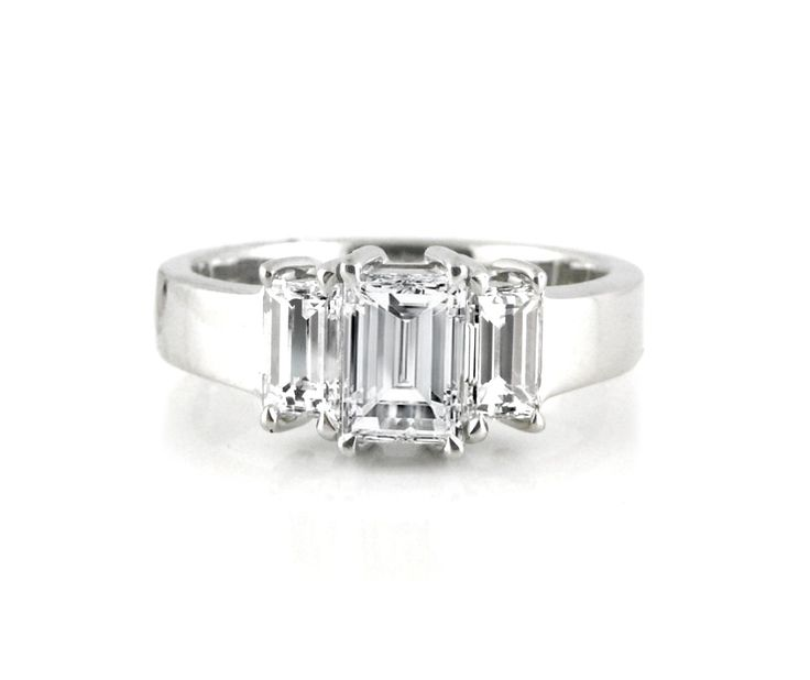 An 18ct White Gold and Baguette Cut Diamond Three Stone Ring