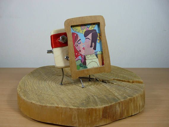 Wooden statue and picture frame/ Wooden Robot The Notorious