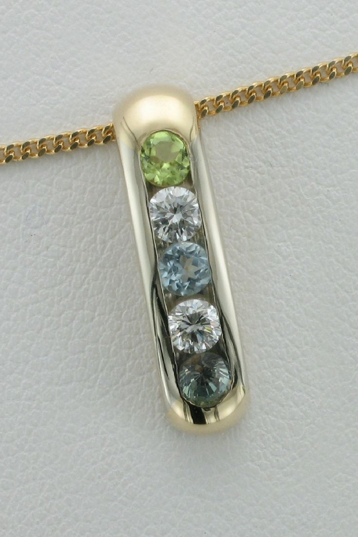 An elegant, but simple custom made necklace by Wong Ken's.  #pendant #necklace #gold #gems