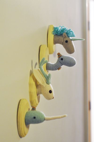 crocheted animals, if I ever have kidd I'm making these for their walls