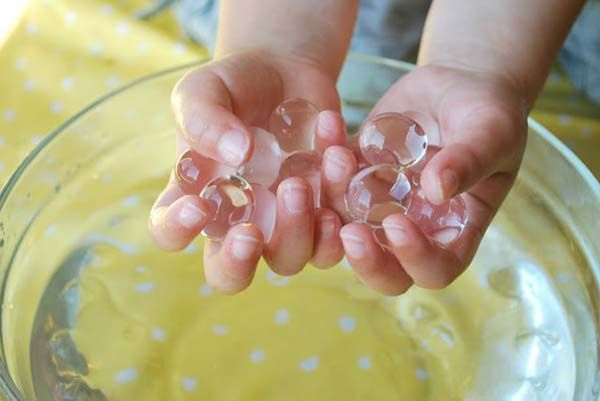 16.) Let your kids experiment with water marbles.