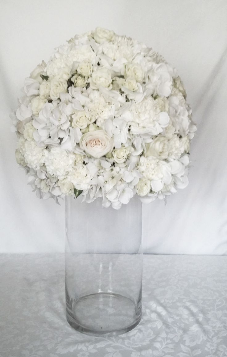 All-white arrangement with imported  roses for the Mohair stand