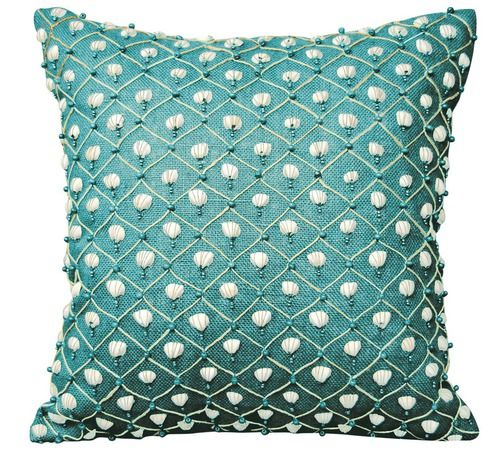 A pattern of hand-beaded shells and tiny turquoise beads in a netted pattern adorn this fabulously created turquoise fabric coastal luxury pillow.