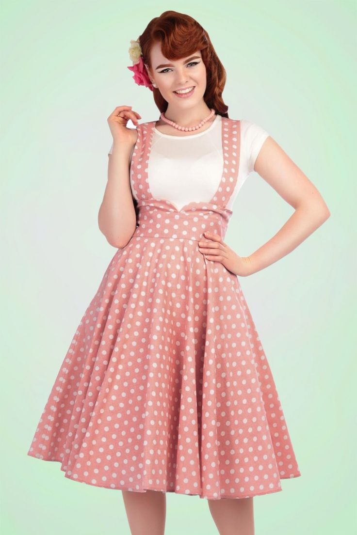 This 50s Mary Vintage Polkadot Swing Skirt is going to be your new BFF!The waist is beautifully emphasized by a cute rounded trim and gives you a gorgeous slim silhouette, vavavoom!The braces, which can also be crossed, create a playful effect, but can easily be detached, which makes it possible to wear this skirt in many ways. Made from a supple, light stretchy light pink cotton blend with a cute white polkadot print. This versatile beauty is an indispensable item!   Swing skirt...